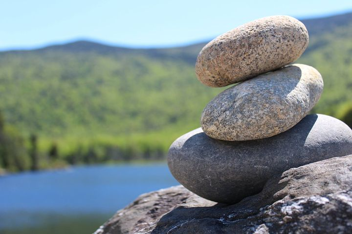 Rocks stacked by lake
