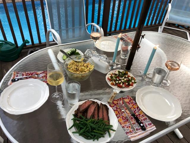 Healthy dinner served outdoors by the swimming pool